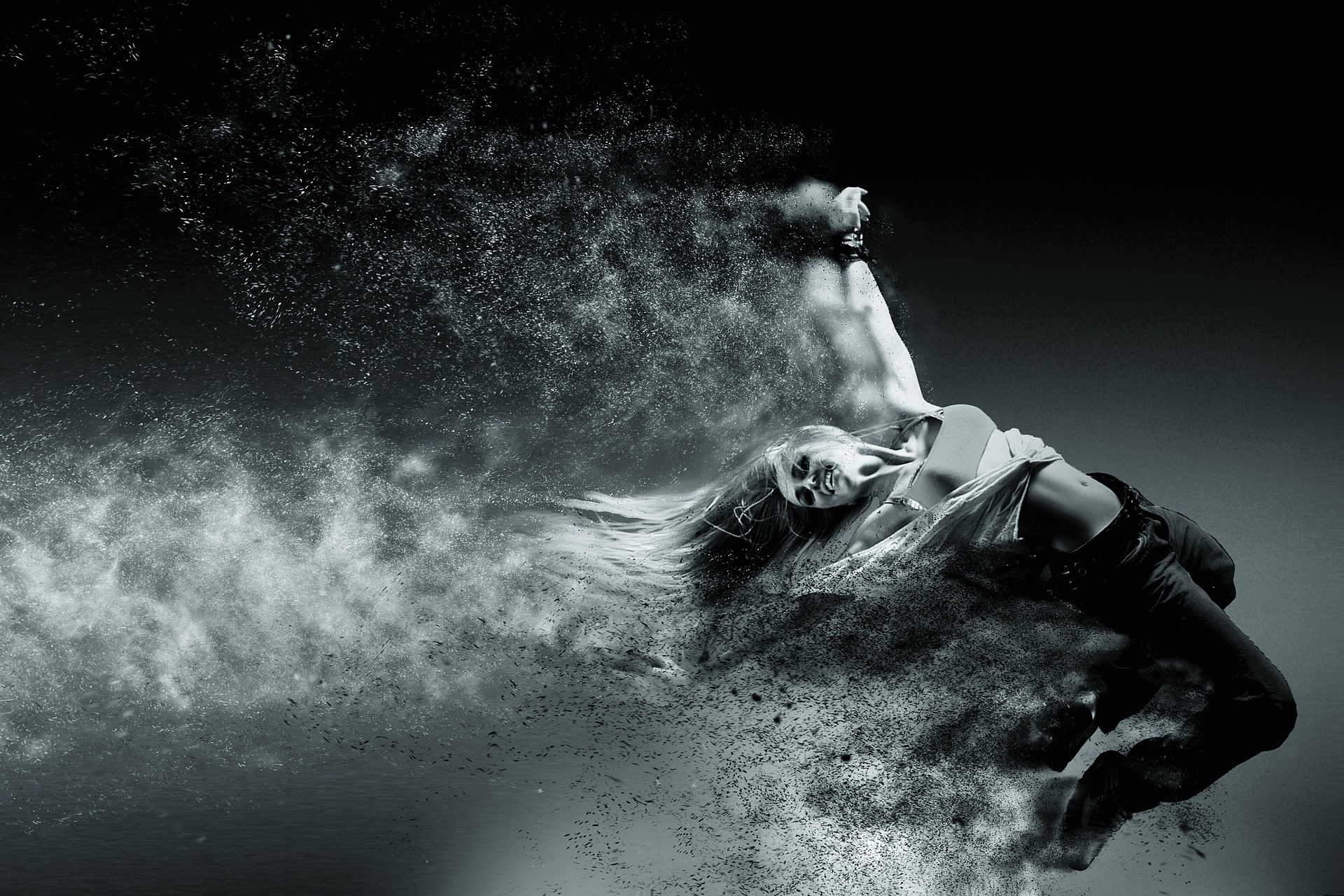 Black and white photo of women being propelled through space and dissolving.