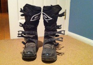 Dirty and dusty dirt bike boots