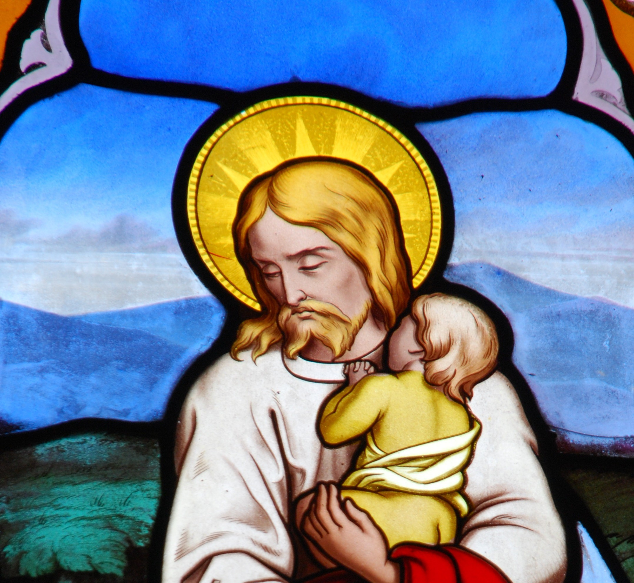 Religious stained glass window with Jesus