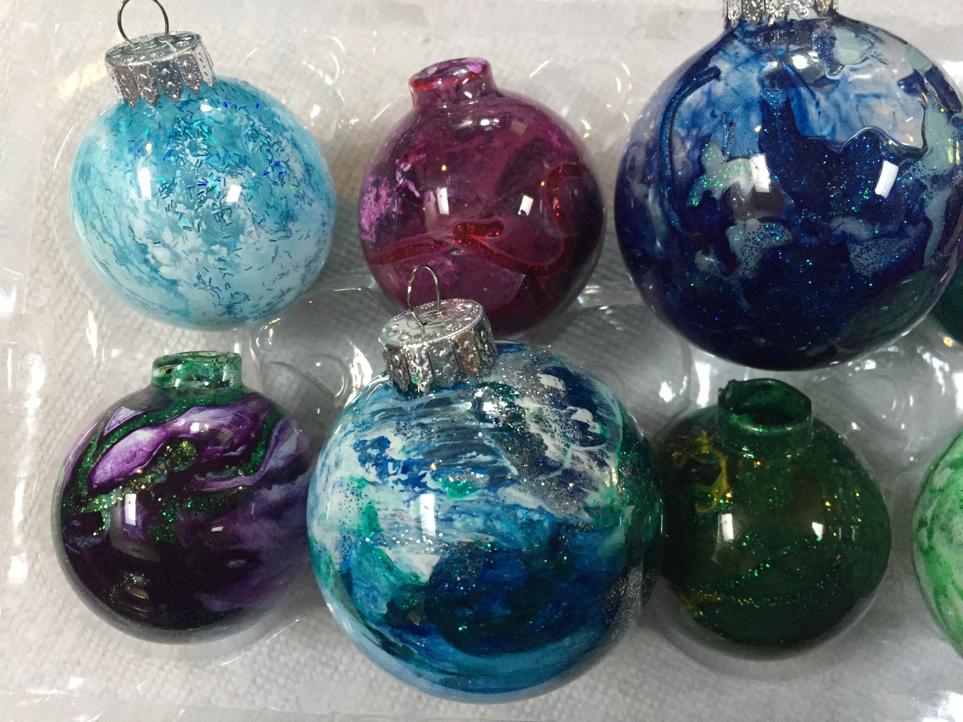 Glass Ornaments hand painted by Lahle Wolfe, blue, purple. green tones