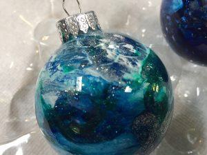 "Christmas ornament painted by Lahle Wolfe using her trademark ""reverse dirty flip"" technique. 2017"