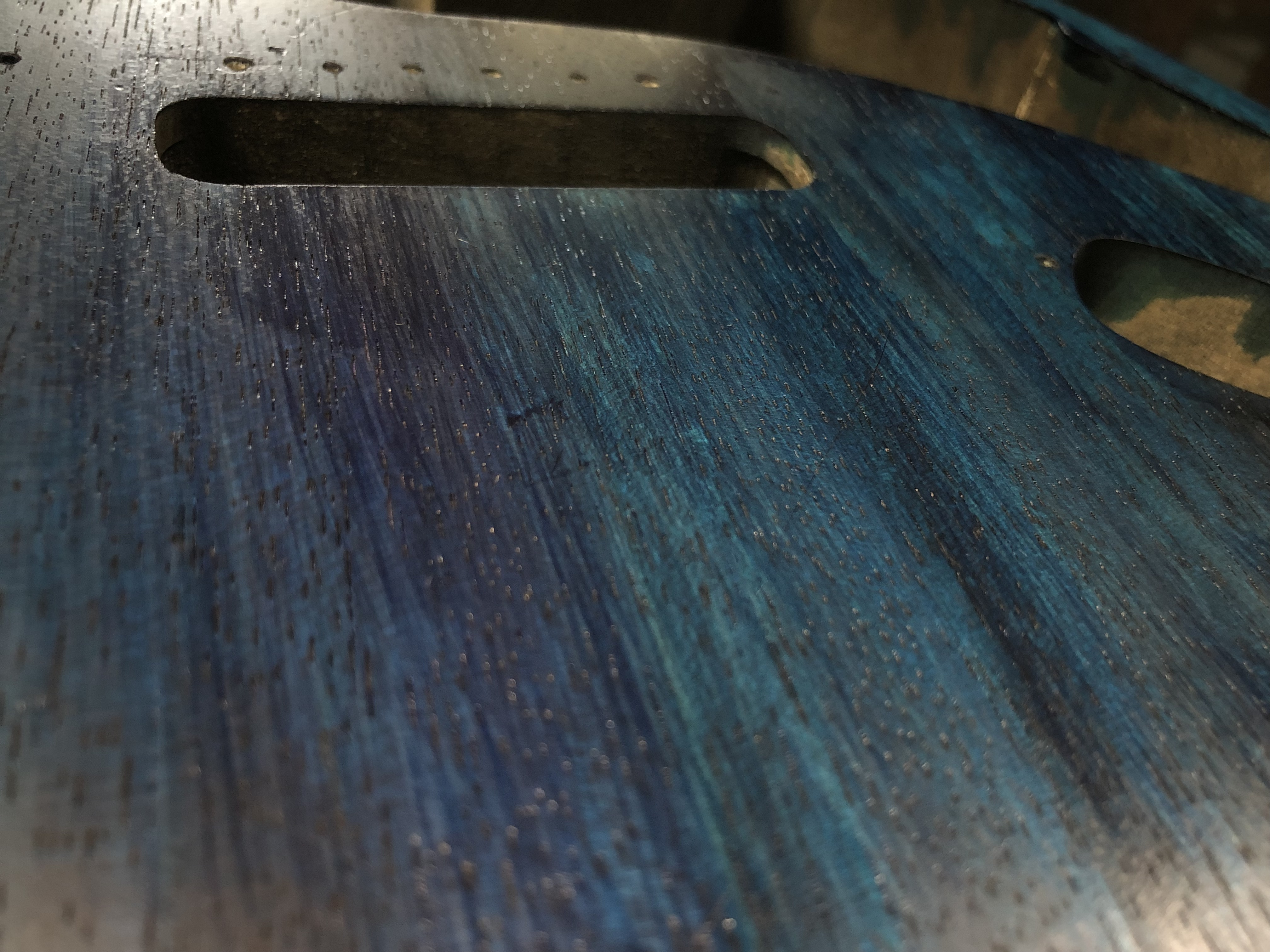 Closeup photo of Strat body with custom dye ink work by Lahle Wolfe